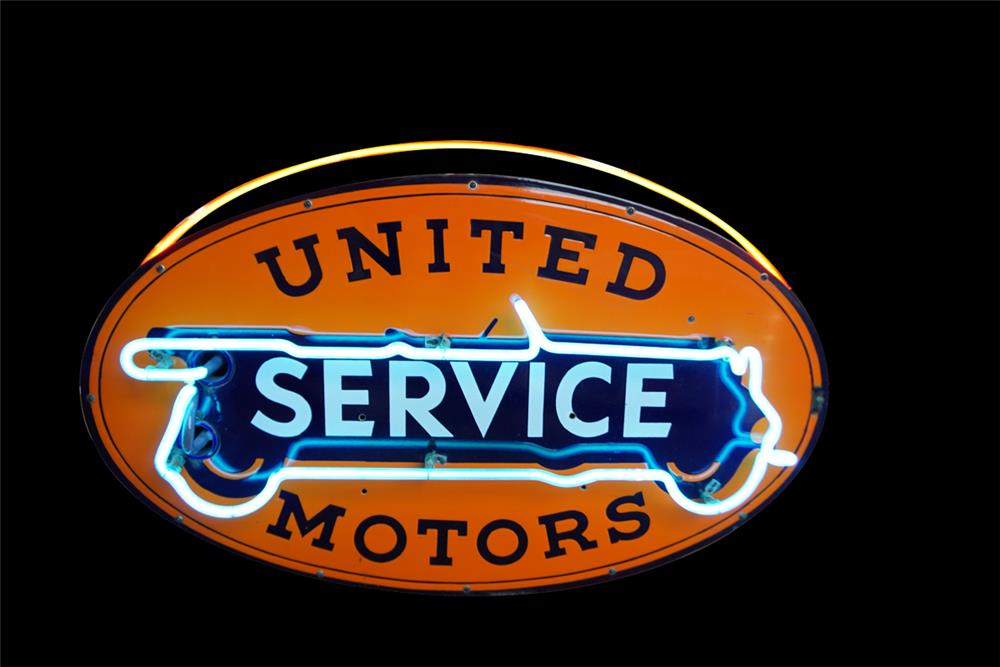 Beautiful 1930s GM United Motors Service double-sided neon porcelain automotive garage sign with touring car graphic. - Front 3/4 - 189875