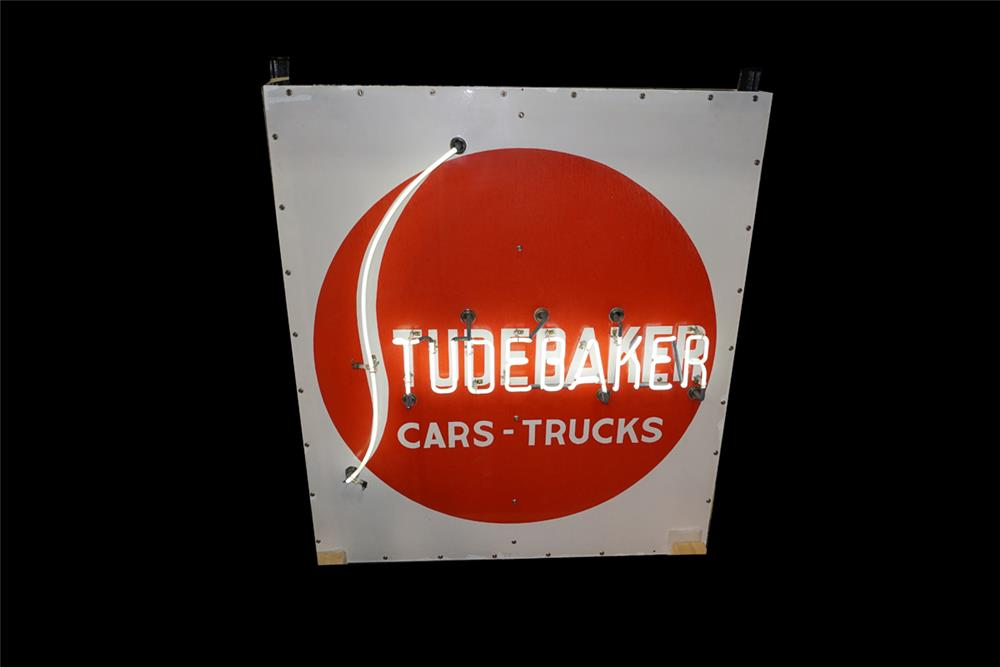 Very unusual 1940s Studebaker Cars-Trucks double-sided neon porcelain dealership sign. - Front 3/4 - 189877