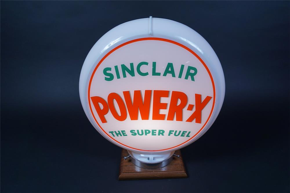 "Circa 1950s Sinclair Power X ""The Super Fuel"" gas pump globe presented in a Capcolite body. - Front 3/4 - 190662"
