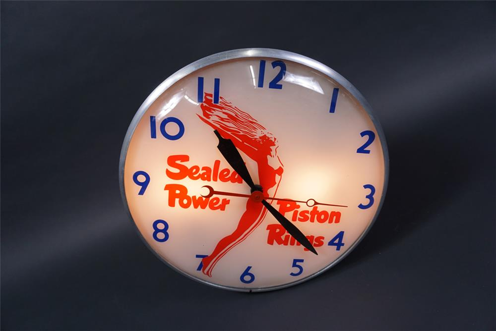Gorgeous Sealed Power Piston Rings glass-faced light-up automotive garage clock. - Front 3/4 - 190757