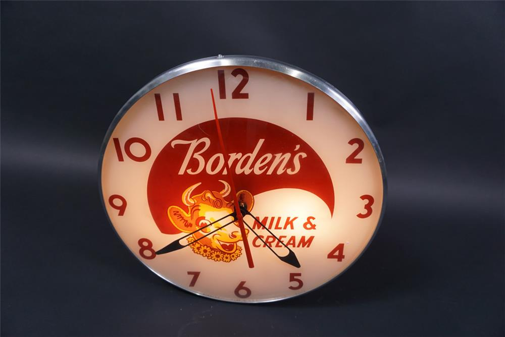 Highly desirable 1950s Borden's Milk & Cream glass faced light-up clock - Front 3/4 - 190760