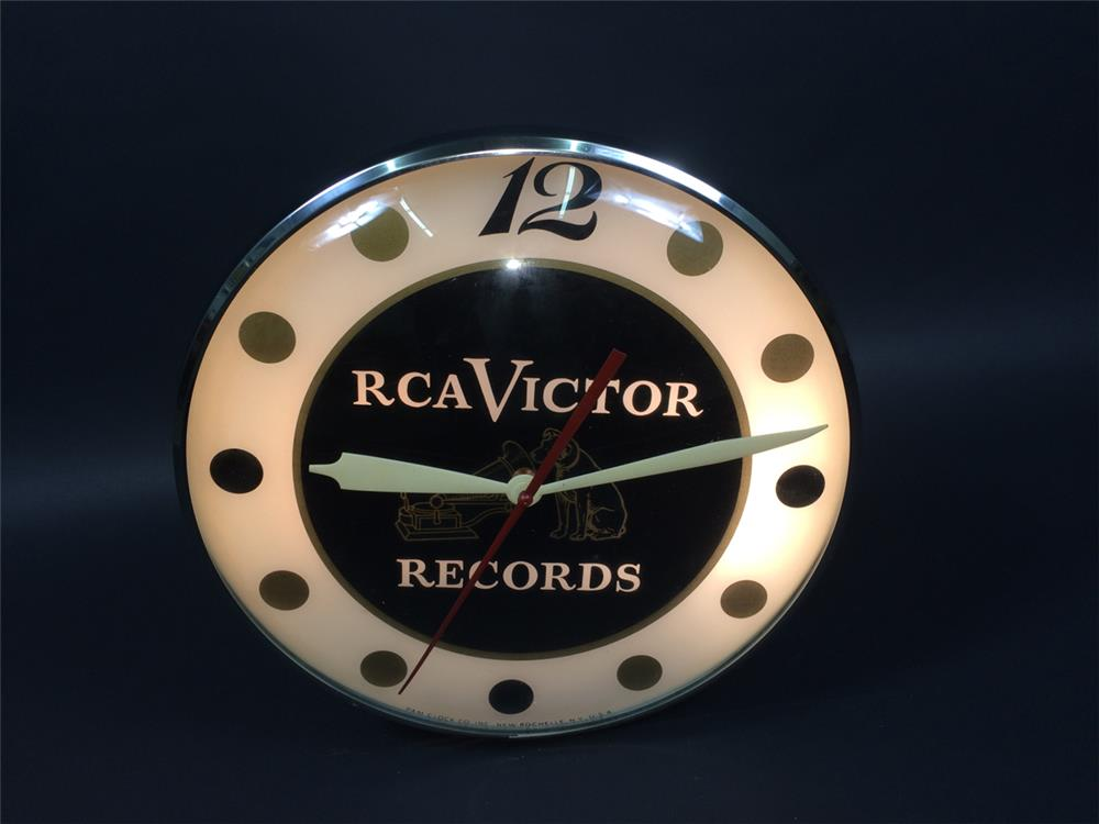 Circa early 1960s RCA Victor Records glass faced light up clock with Nipper logo. - Front 3/4 - 190768