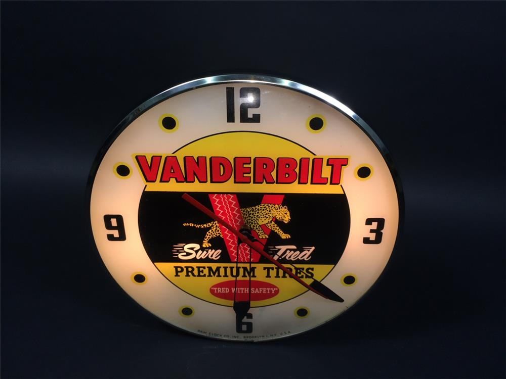 Good-looking 1950s Vanderbilt Premium Tires glass-faced light-up service station clock. - Front 3/4 - 190769