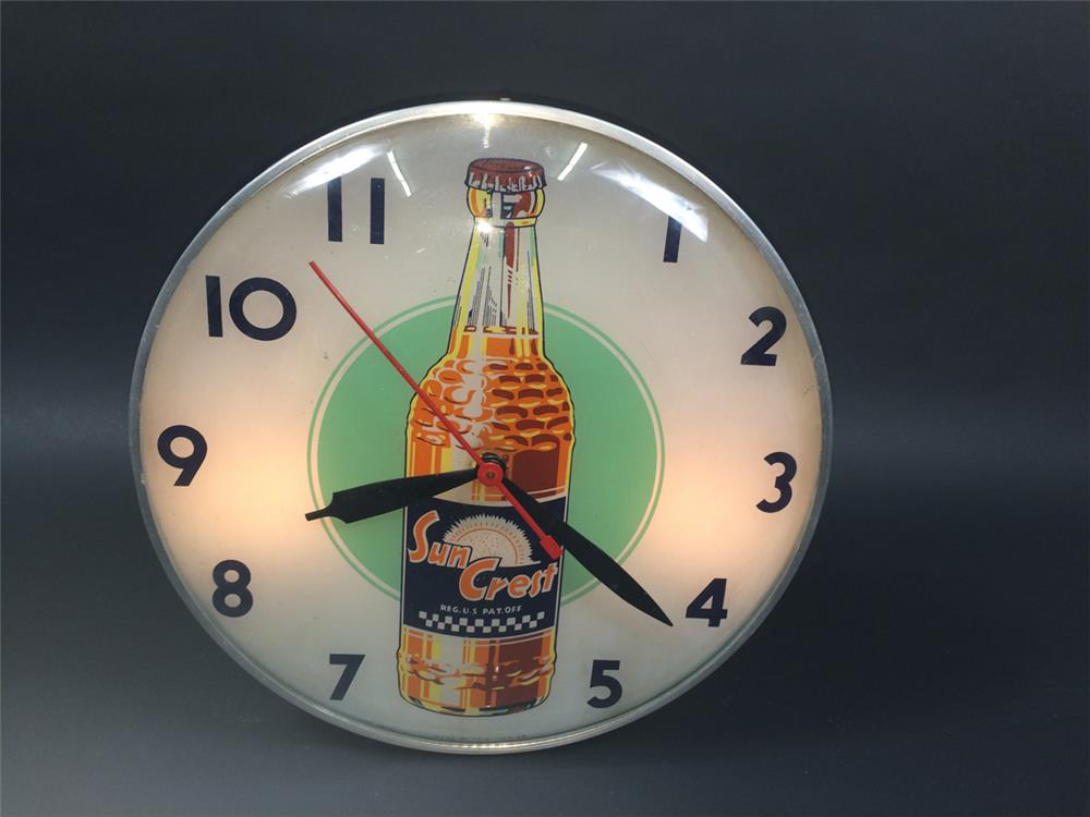 Exceptional 1950s Suncrest Orange Soda glass-faced light-up diner clock. - Front 3/4 - 190771