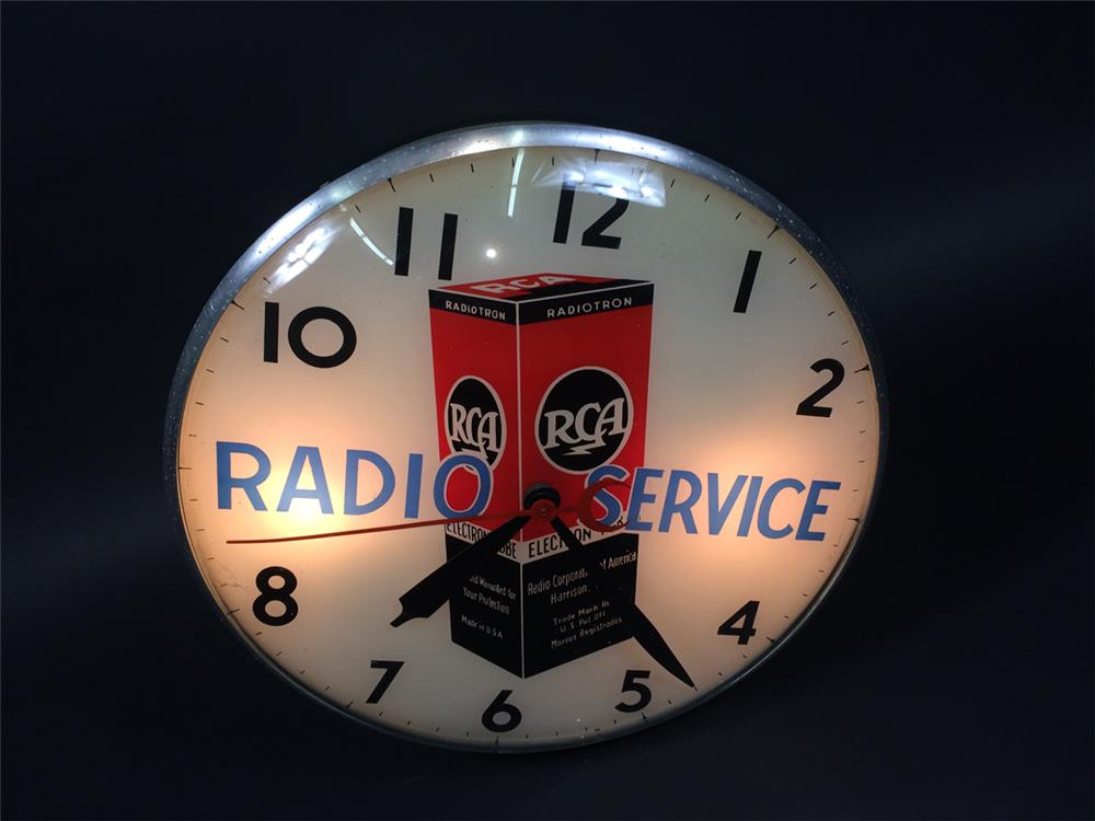 Sharp 1950s RCA Radio Service glass faced light-up clock with graphics. - Front 3/4 - 190773