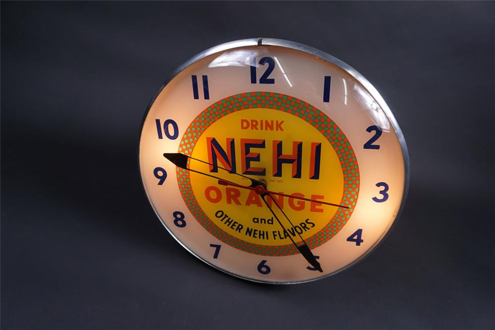 Late 1940s Nehi Orange Soda glass faced light-up diner clock. - Front 3/4 - 190844