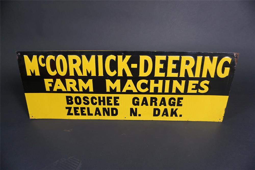 NOS 1930s McCormick-Deering Farm Machines single-sided embossed tin sign. - Front 3/4 - 190877