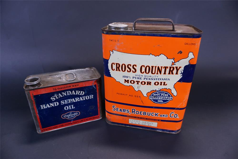 Lot consisting of a 1920s Standard half-gallon tin and a 1930s two-gallon Sears Cross Country Motor Oil tin. - Front 3/4 - 191434