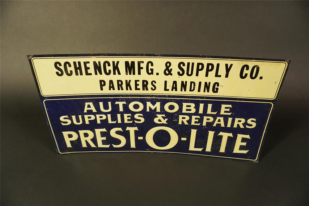 Late 1920s-30s Prest-O-Lite Automobile Accessories single-sided embossed tin automotive garage sign. - Front 3/4 - 191629