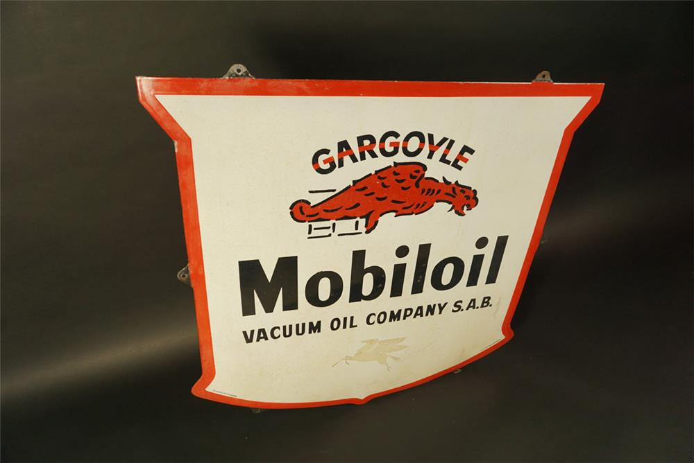 Very unusual 1948 Gargoyle Mobil Oil Vacuum Oil Company single-sided porcelain shield shaped sign. - Front 3/4 - 191719