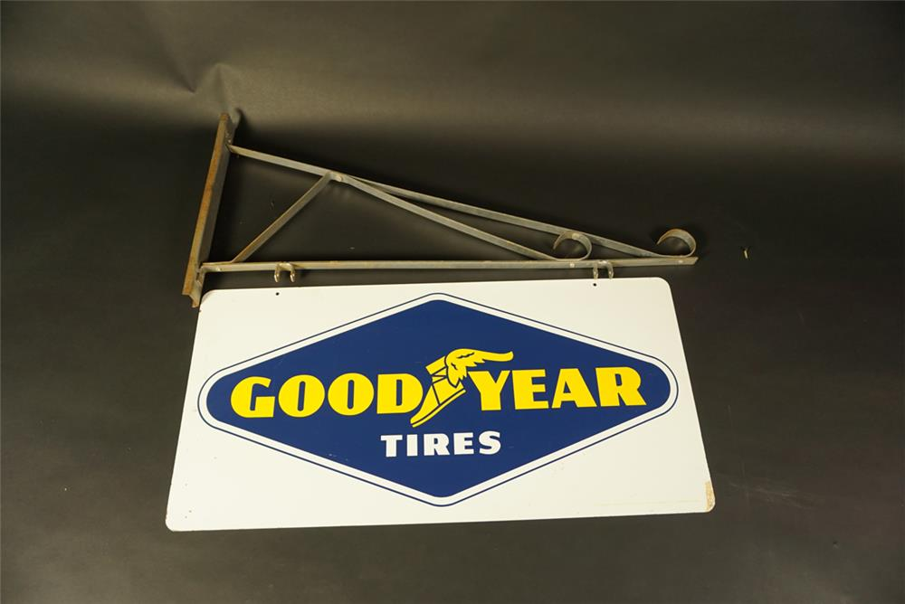 Choice NOS 1964 Goodyear Tires double-sided tin automotive garage sign with original hanger. - Front 3/4 - 192076