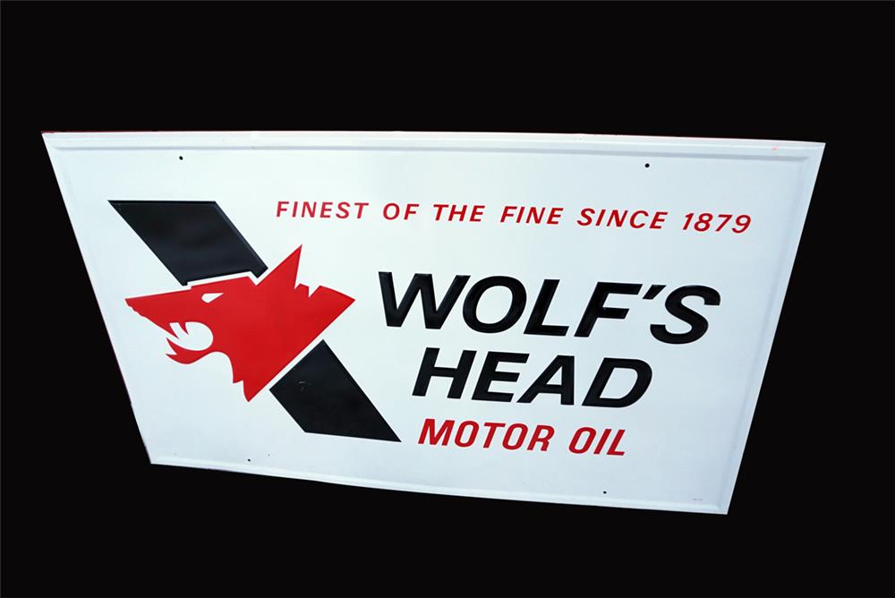 "Large NOS Wolf's Head Motor Oil ""The Finest of Fine"" single-sided embossed tin service station sign. - Front 3/4 - 192081"