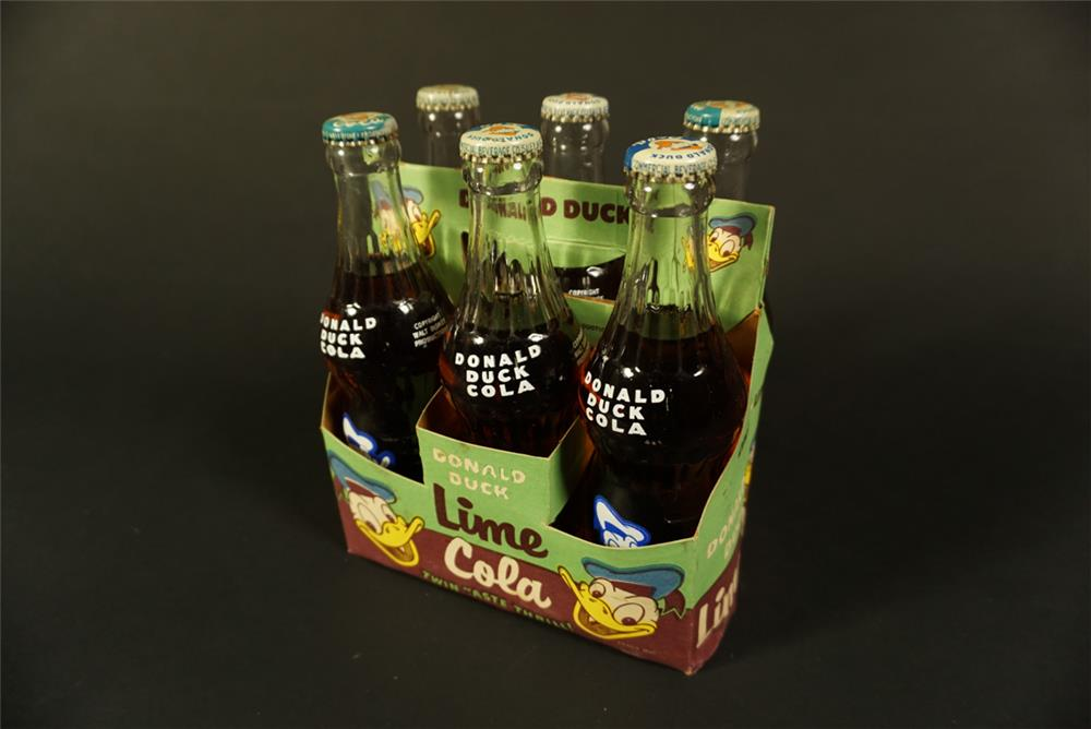 Rare 1950s six pack carton of Donald Duck Lime Cola in glass bottles. - Front 3/4 - 192100