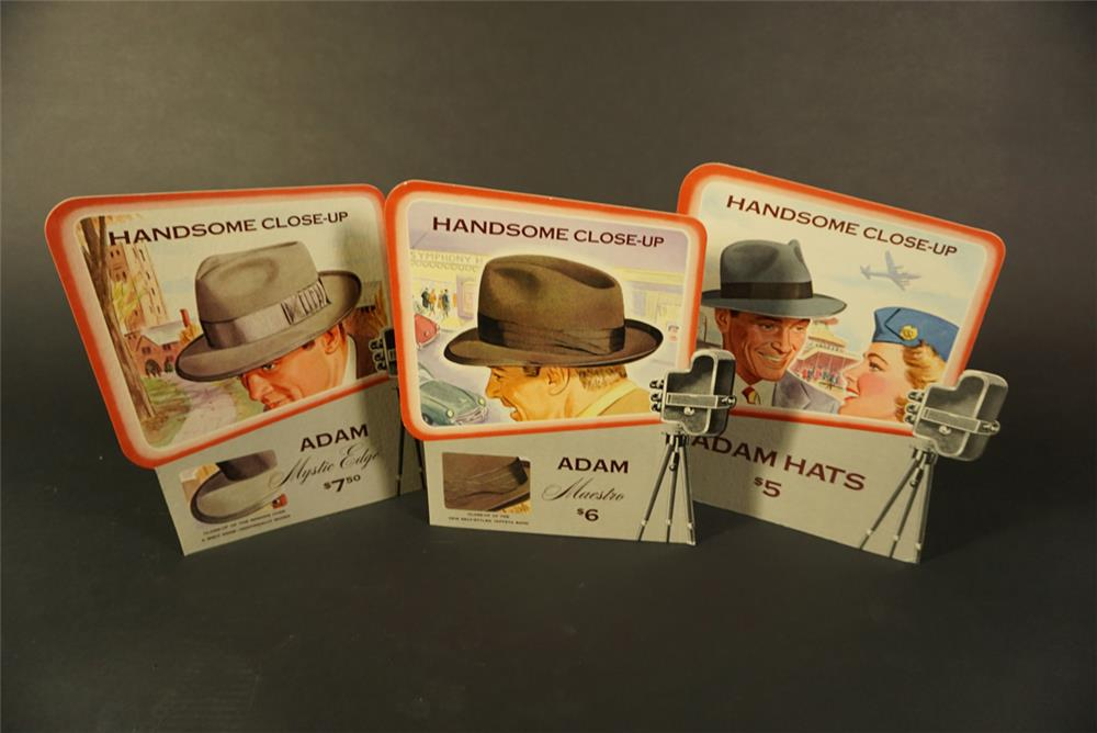Fantastic lot of three circa late 1940s-early 50s Adam Hats store display cardboard signs with ease backs. - Front 3/4 - 192108
