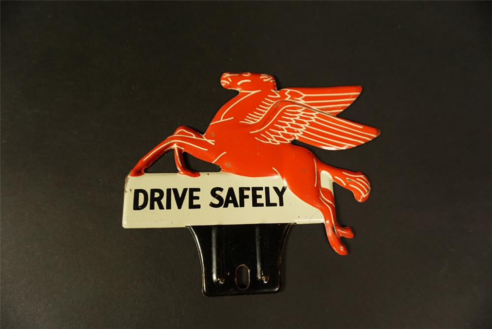 Good-looking 1930s Mobil Oil Drive Safely Pegasus-shaped tin license plate attachment sign. - Front 3/4 - 192145