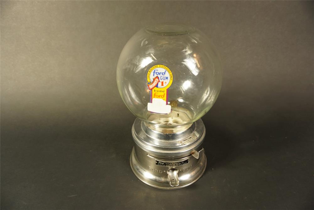 "Late 1950s Ford One-Cent glass domed gumball machine. Complete with lock and key. Condition: Excellent+ Size 8""x12""x8"" - Front 3/4 - 192159"