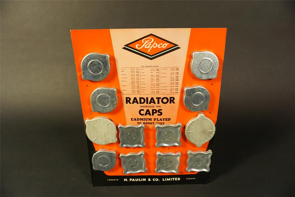 NOS 1949 Papco Radiator Caps for GM Cars countertop display. - Front 3/4 - 192163