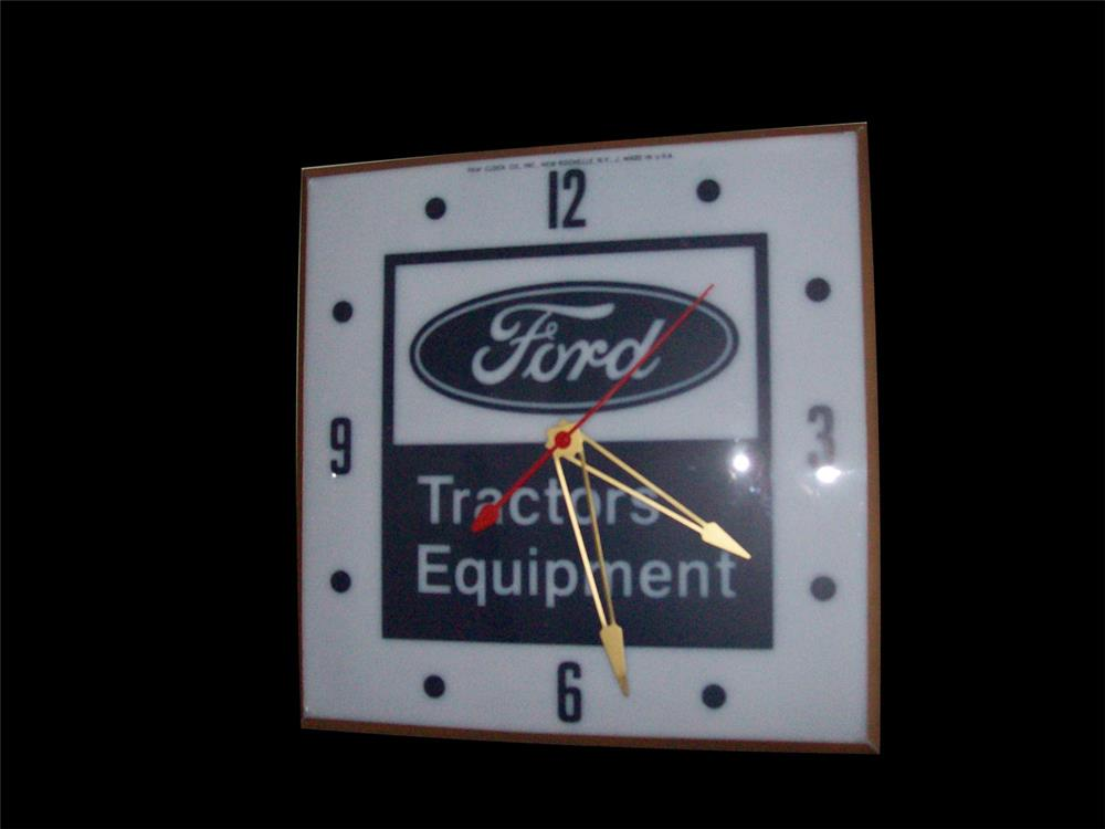 Circa 1960s Ford Tractors Equipment glass-faced light-up dealership clock by Pam Clock Company. - Front 3/4 - 192335