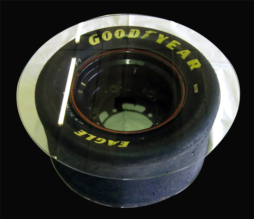 Darrell Gwynn's personal Nascar wheel and tire glass top table. - Front 3/4 - 192471