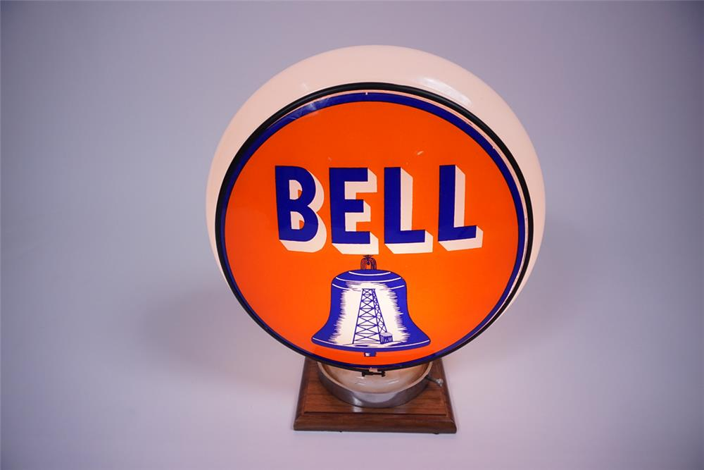 Lot #6344 Beautiful 1930s Bell Gasoline Gill-bodied glass gas pump globe with oil derrick graphics.