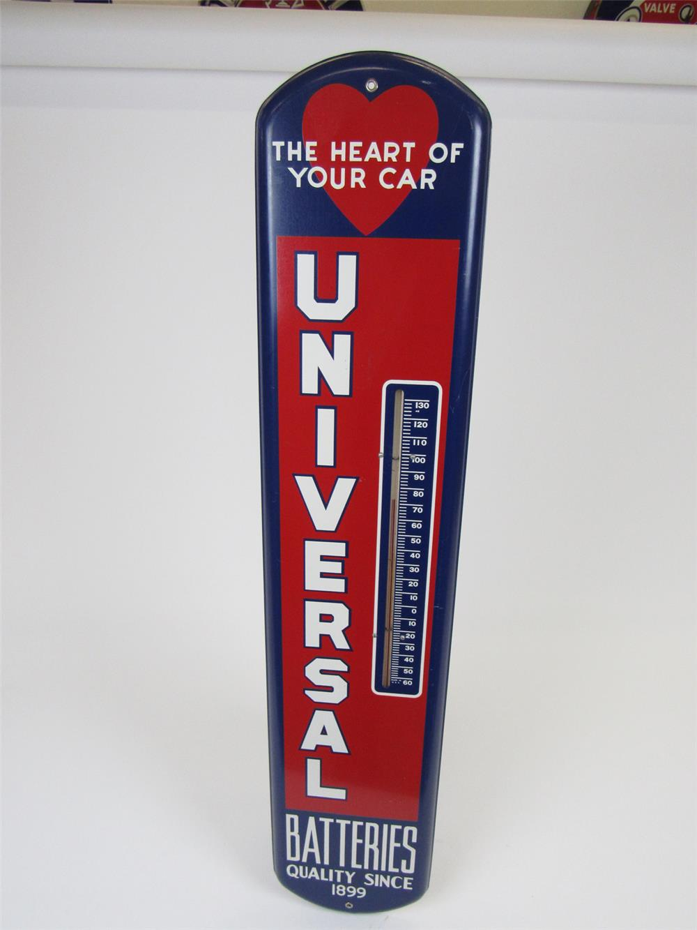"Very nice circa 1940s Universal Batteries ""The Heart of Your Car"" single-sided tin service station thermometer. - Front 3/4 - 202700"
