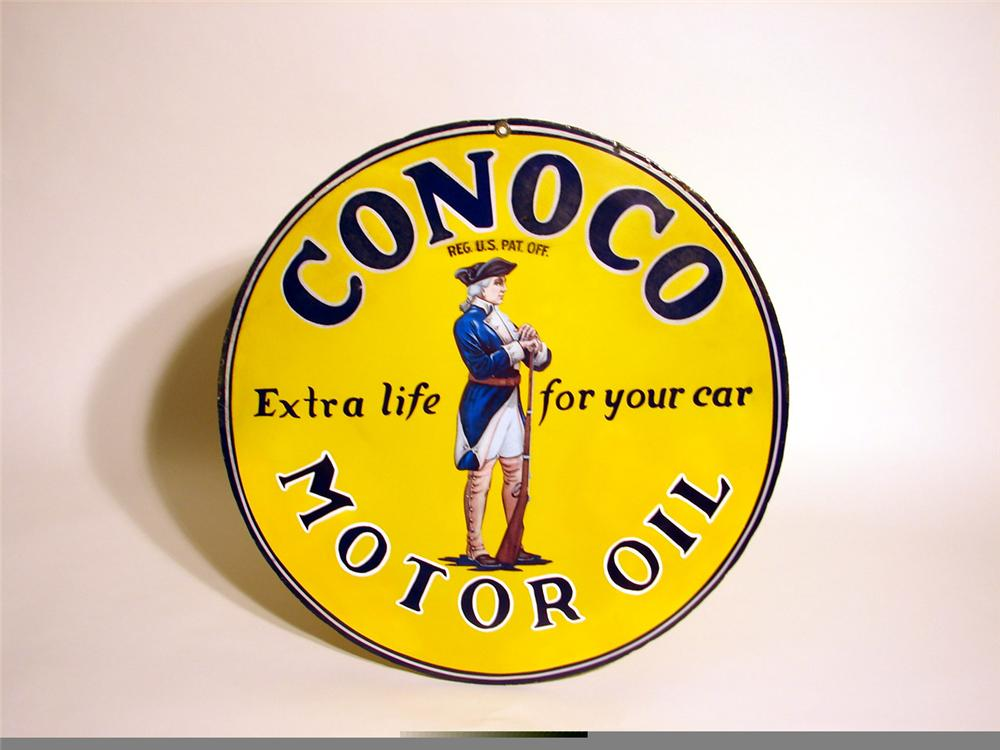 Very scarce 1920s Conoco Motor Oil double-sided porcelain station sign with minuteman graphic. - Front 3/4 - 45712