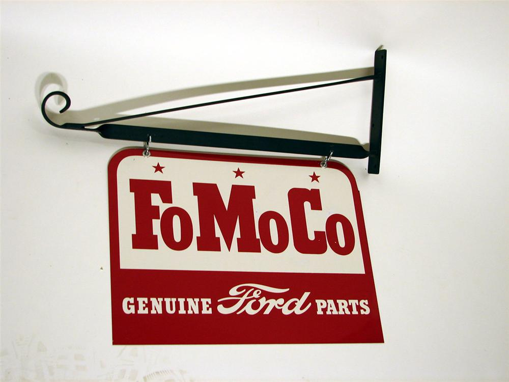 Scarce N.O.S. 1950s Ford FoMoCo Genuine Parts double-sided tin garage sign with hanging bracket. - Front 3/4 - 45718