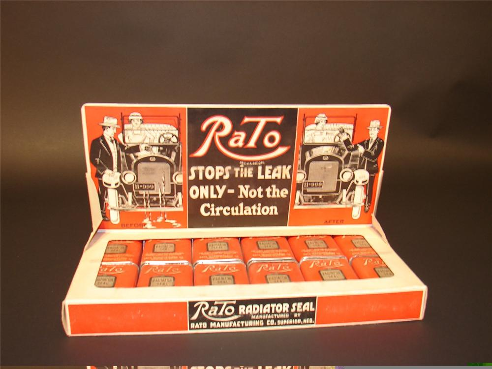 Unequaled N.O.S. 1911 Rato Radiator Stop Leak counter-top garage display complete with 12 N.O.S. tins. - Front 3/4 - 45973
