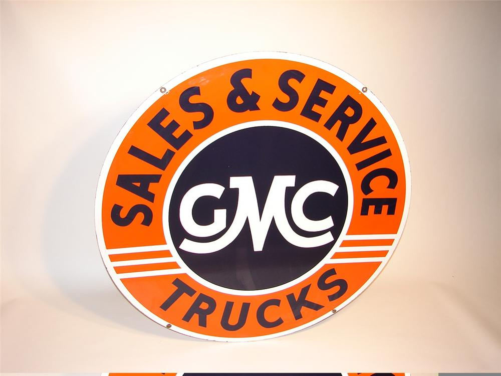Superb late 40s-50s GMC Trucks Sales and Service double-sided porcelain dealership sign. - Front 3/4 - 45975