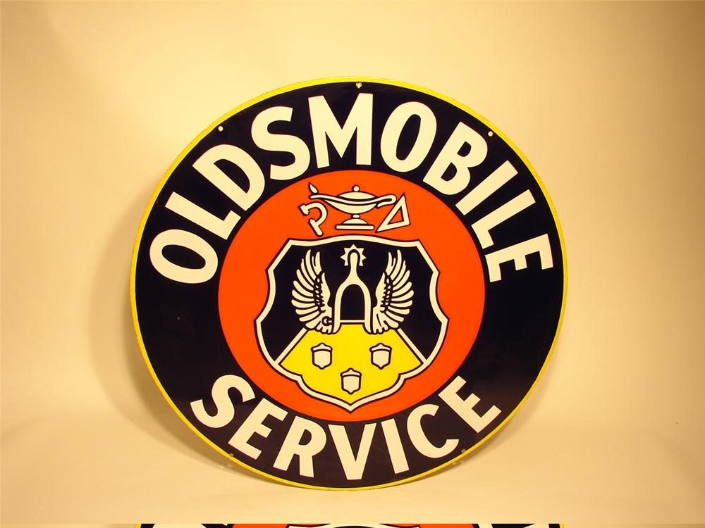 Very nice 1940s Oldsmobile Service double-sided porcelain dealership sign with Acorn logo. - Front 3/4 - 46056