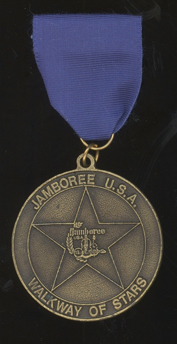 Johnny Cash medal presented when inducted to the Jamboree USA Walkway of Stars, 1983. - Front 3/4 - 46307