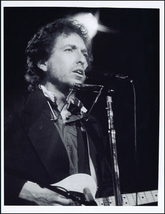 Bob Dylan harmonica and rack. A harmonica and rack owned and played by Bob together of a photograph of him playing it. - Rear 3/4 - 46463