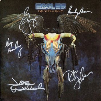 The Eagles signed album cover. A copy of the album One of These Nights signed by the band in silver pen. - Front 3/4 - 46486