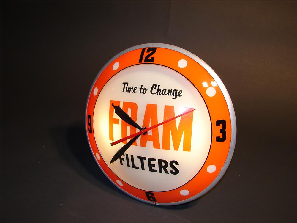 1950s Fram Filters double-bubble light-up dealership clock. - Front 3/4 - 46670