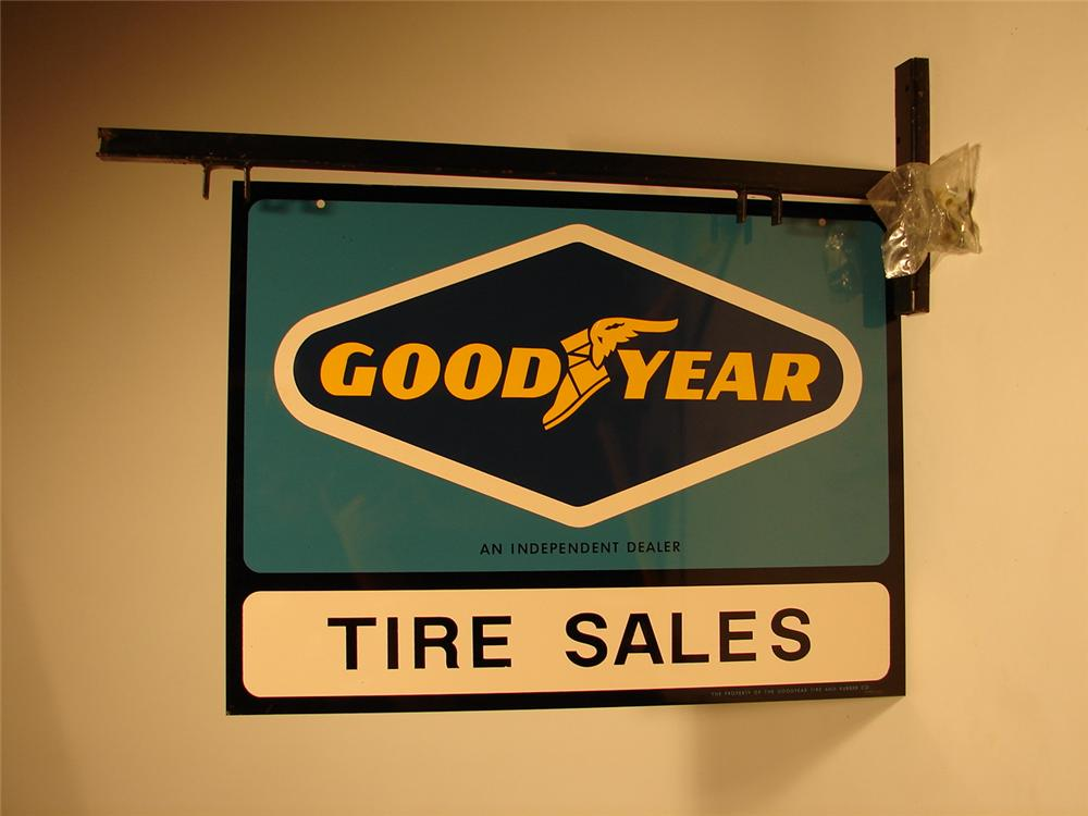 N.O.S. Goodyear Tire Sales double-sided tin garage sign with original hanging bracket. - Front 3/4 - 46687