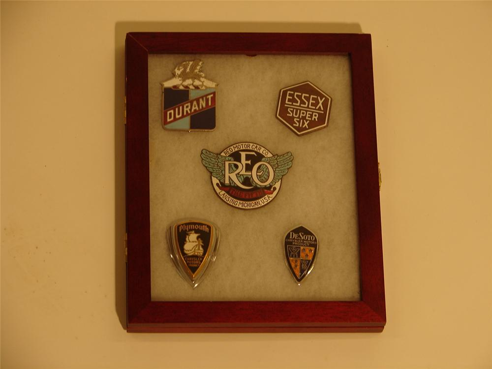 Nice set of five vintage enameled car badges circa 1920s-40s including; Reo, Durant, Essex, Plymouth and DeSoto. - Front 3/4 - 46692