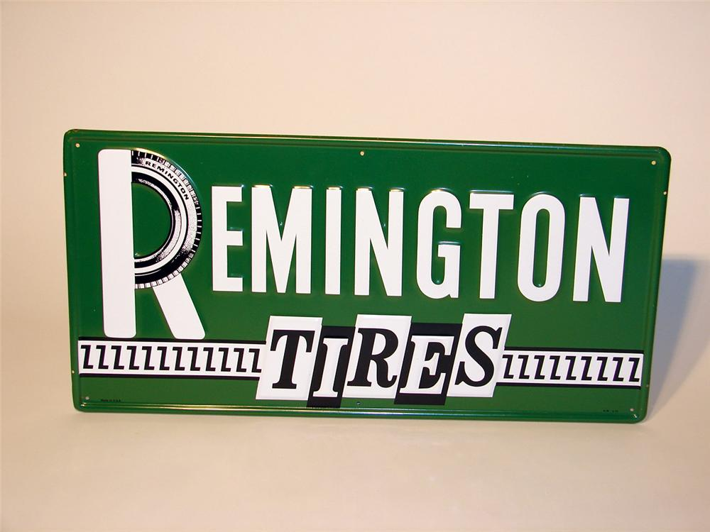 Terrific N.O.S. Remington Tires embossed horizontal tin garage sign. - Front 3/4 - 46776
