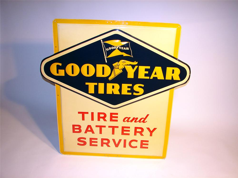 Stellar 1950s Goodyear Tire and Battery Service convexed embossed tin garage sign. - Front 3/4 - 46850