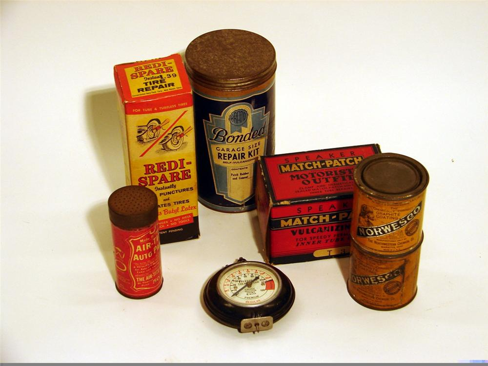 Assorted lot of seven tire repair tins and paraphernalia 1930s-50s including a Bakelite Firestone tread tester. - Front 3/4 - 46868