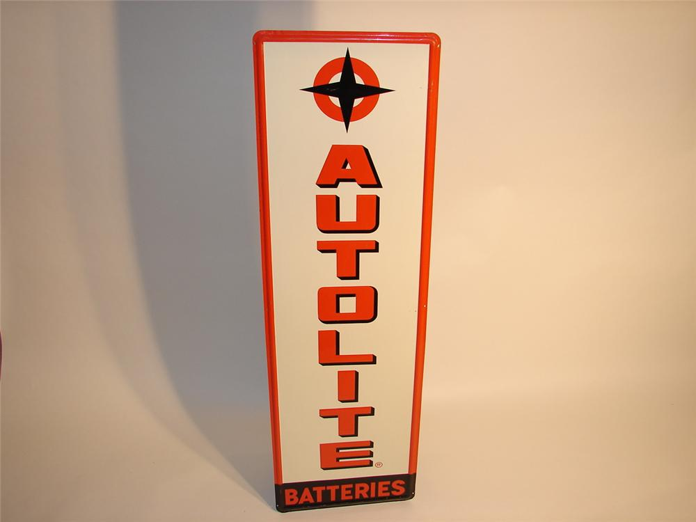 N.O.S. early 60s Ford Autolite Batteries embossed tin vertical garage sign. - Front 3/4 - 46884