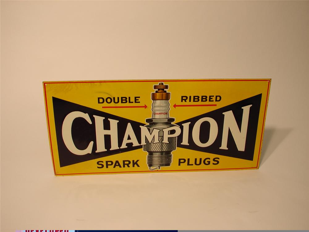 N.O.S.1930s Champion Spark Plugs embossed tin garage sign with awesome plug graphic. - Front 3/4 - 47064