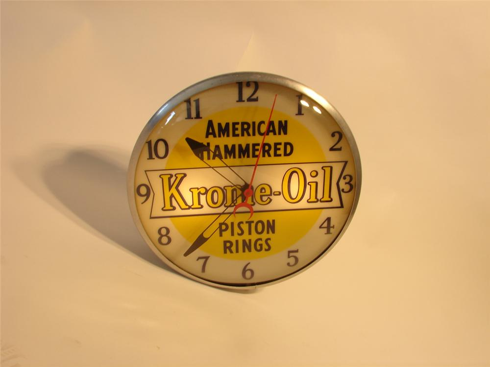 1950s Krome-Oil American Hammered Piston Rings light-up station clock. - Front 3/4 - 47099