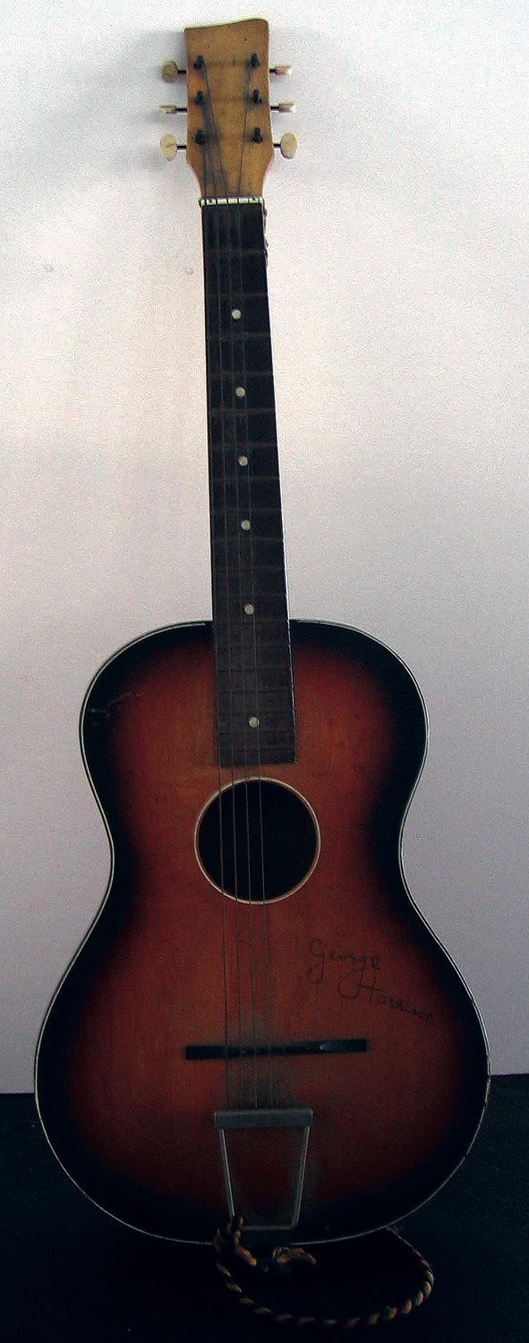 George Harrison signed acoustic guitar, together