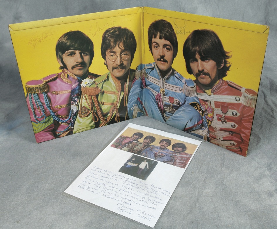 The Beatles Sgt. Peppers LP signed by John, Paul and Ringo, 1967. RESERVE. - Front 3/4 - 47864