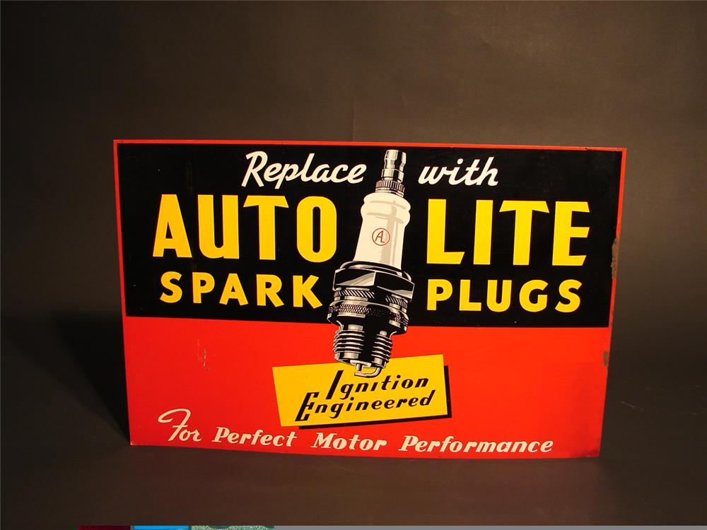 "1930s Auto-Lite Spark Plugs tin sign with spark plug graphic.  Size 28""x18"" - Front 3/4 - 48376"