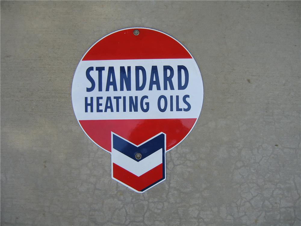 N.O.S. Standard Heating Oils single-sided porcelain pump plate sign. - Front 3/4 - 48622