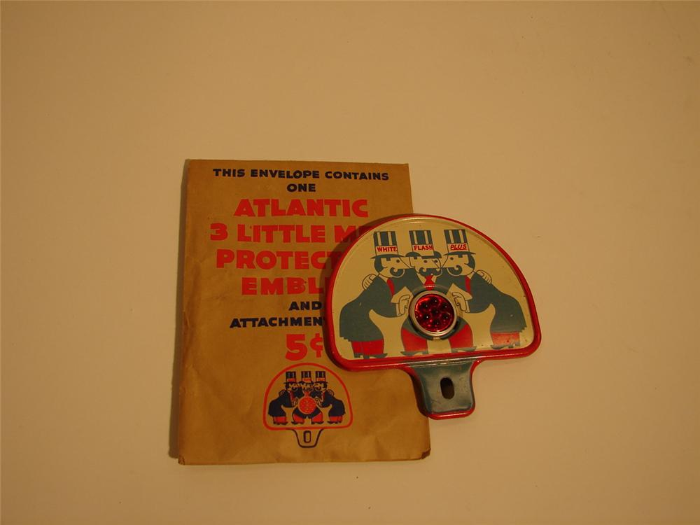 N.O.S. 1930s Atlantic Gasoline license plate attachment sign still in the original shipping paper. - Front 3/4 - 49987