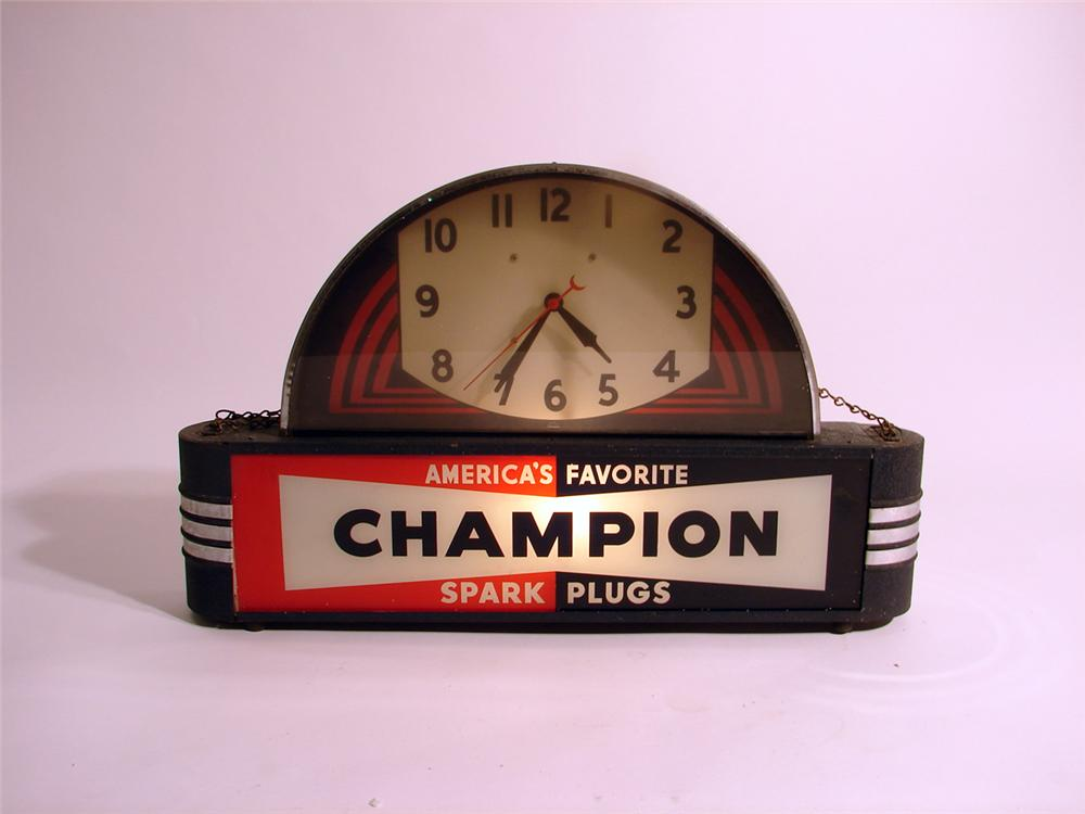 Superb 1930s Champion Spark Plugs art deco influenced light-up station clock. - Front 3/4 - 49992