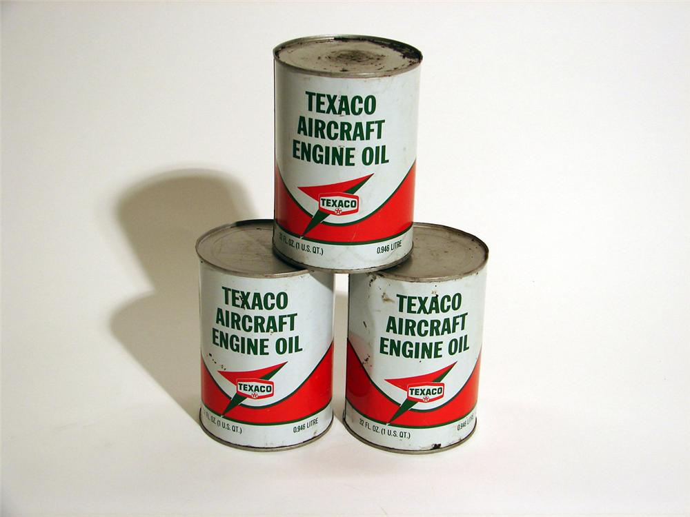 Lot of three N.O.S. 1950s Texaco Aviation Oil metal quart cans. - Front 3/4 - 50084