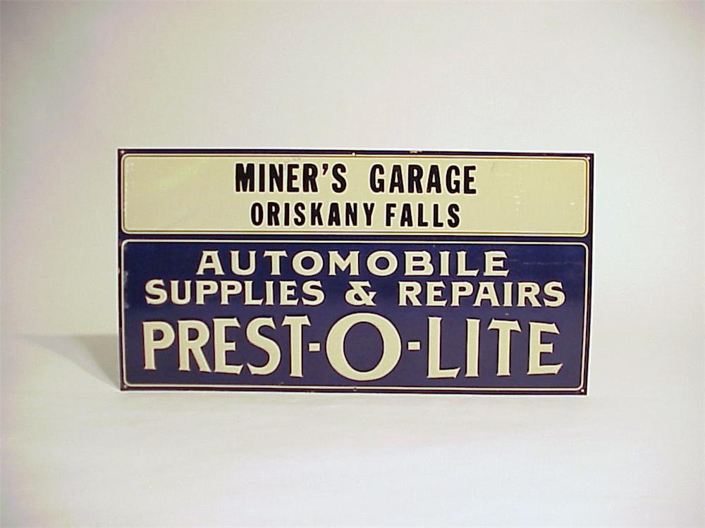 N.O.S. 1920s-30s Prest-o-lite  Automobile Supplies single-sided embossed tin garage sign. - Front 3/4 - 50094